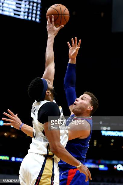 Blake Griffin of the LA Clippers has his shot blocked by Anthony Davis of the New Orleans Pelicans during the second half at the Smoothie King Center...