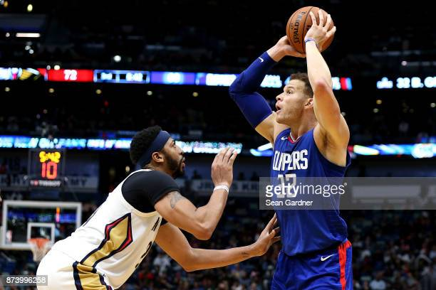 Blake Griffin of the LA Clippers is defended by Anthony Davis of the New Orleans Pelicans during the second half at the Smoothie King Center on...