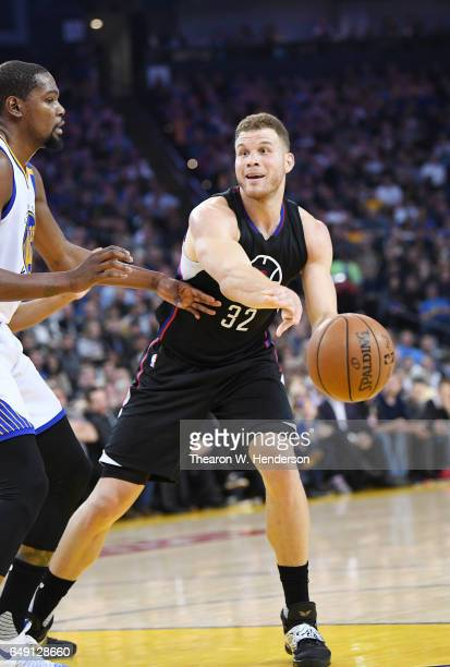 Blake Griffin of the LA Clippers looks to passes the ball by Kevin Durant of the Golden State Warriors during an NBA basketball game at ORACLE Arena...