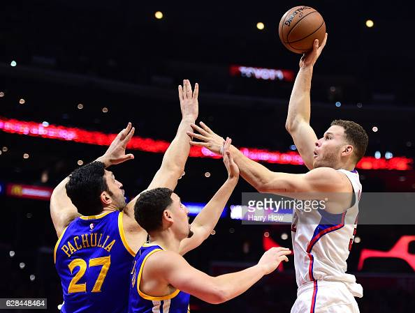 Blake Griffin of the LA Clippers shoots over Zaza Pachulia and Klay Thompson of the Golden State Warriors during a 11598 Warriors win at Staples...