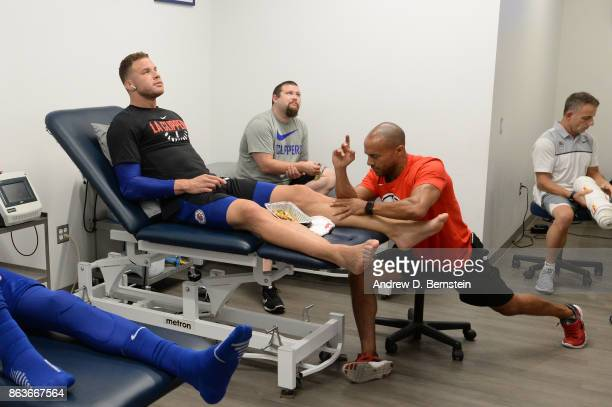 Blake Griffin of the LA Clippers stretches before the game against the Los Angeles Lakers on October 19 2017 at STAPLES Center in Los Angeles...