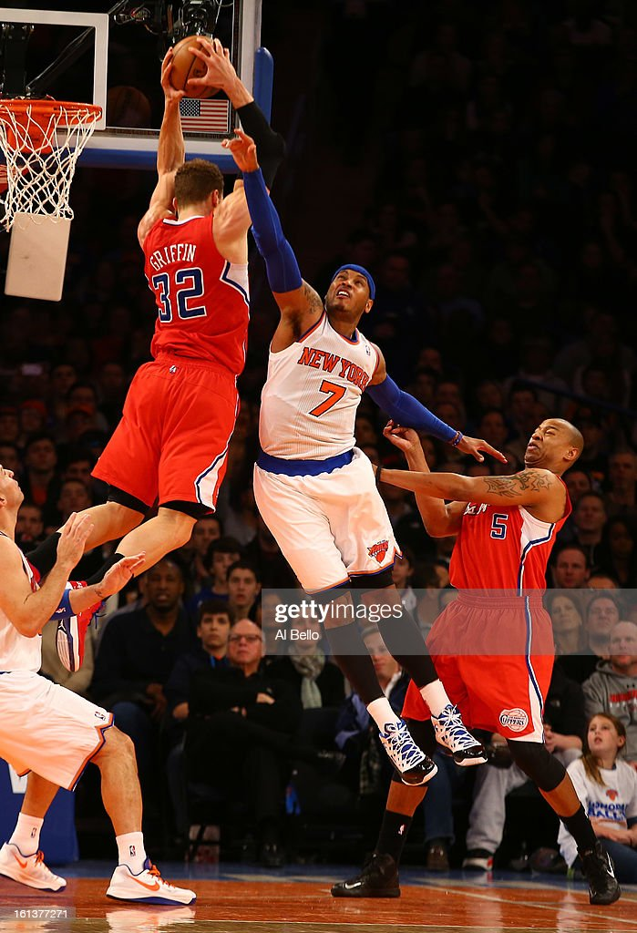Blake Griffin #32 of the Los Angeles Clippers and Carmelo Anthony #7 of the New York Knicks reach for a rebound during their game at Madison Square Garden on February 10, 2013 in New York City.