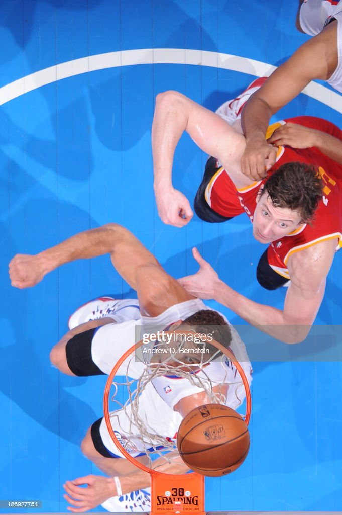 Blake Griffin #32 of the Los Angeles Clippers and Omer Asik #3 of the Houston Rockets prepare for a rebound during their game at Staples Center on November 4, 2013 in Los Angeles, California.