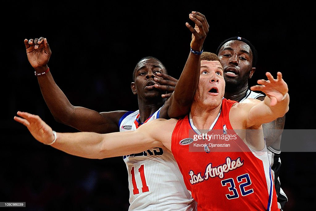 <a gi-track='captionPersonalityLinkClicked' href=/galleries/search?phrase=Blake+Griffin+-+Basketball+Player&family=editorial&specificpeople=4216010 ng-click='$event.stopPropagation()'>Blake Griffin</a> #32 of the Los Angeles Clippers and the Rookie Team posts up against <a gi-track='captionPersonalityLinkClicked' href=/galleries/search?phrase=Jrue+Holiday&family=editorial&specificpeople=5042484 ng-click='$event.stopPropagation()'>Jrue Holiday</a> #11 of the Philadelphia 76ers and the Sophomore Team and <a gi-track='captionPersonalityLinkClicked' href=/galleries/search?phrase=James+Harden&family=editorial&specificpeople=4215938 ng-click='$event.stopPropagation()'>James Harden</a> #13 of the Oklahoma City Thunder and the Sophomore Team in the second half during the T-Mobile Rookie Challenge and Youth Jam at Staples Center on February 18, 2011 in Los Angeles, California.