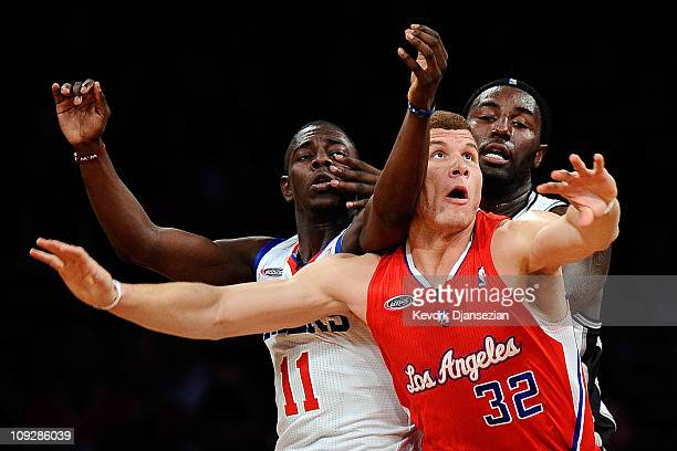 Blake Griffin of the Los Angeles Clippers and the Rookie Team posts up against Jrue Holiday of the Philadelphia 76ers and the Sophomore Team and...