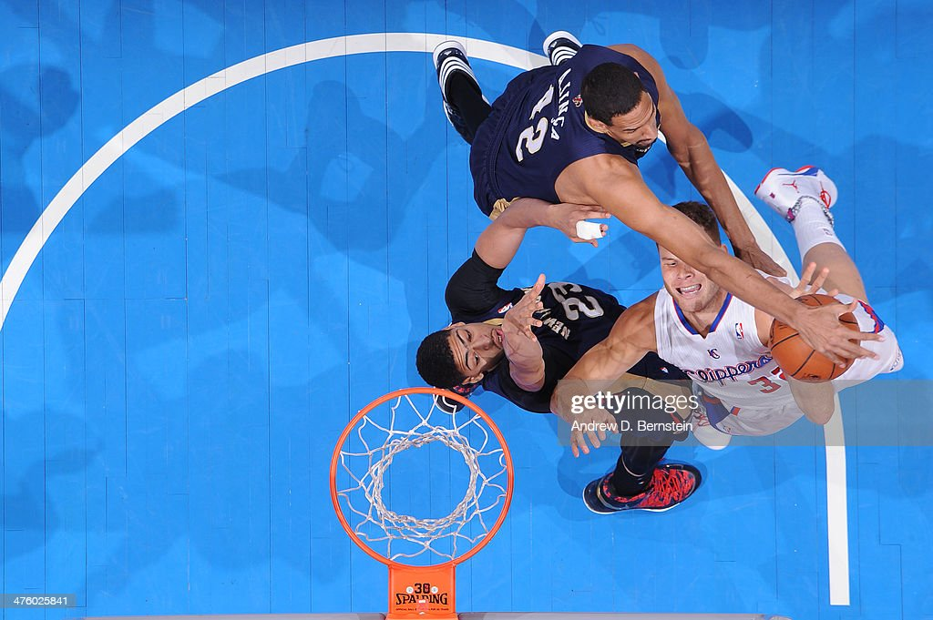 Blake Griffin #32 of the Los Angeles Clippers attempts a dunk over Anthony Davis #23 of the New Orleans Pelicans at STAPLES Center on March 1, 2014 in Los Angeles, California.
