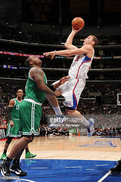 Blake Griffin of the Los Angeles Clippers attempts a shot against Glen Davis of the Boston Celtics at Staples Center on February 26 2011 in Los...