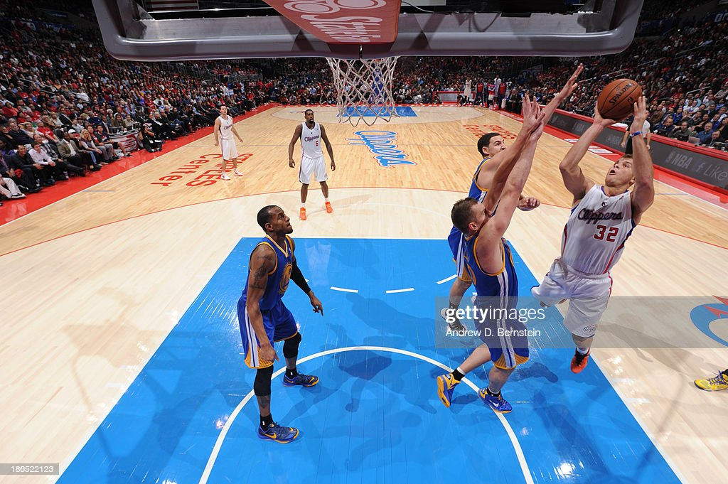 <a gi-track='captionPersonalityLinkClicked' href=/galleries/search?phrase=Blake+Griffin+-+Basketball+Player&family=editorial&specificpeople=4216010 ng-click='$event.stopPropagation()'>Blake Griffin</a> #32 of the Los Angeles Clippers attempts a shot against David Lee #10 of the Golden State Warriors at STAPLES Center on October 31, 2013 at in Los Angeles, California.
