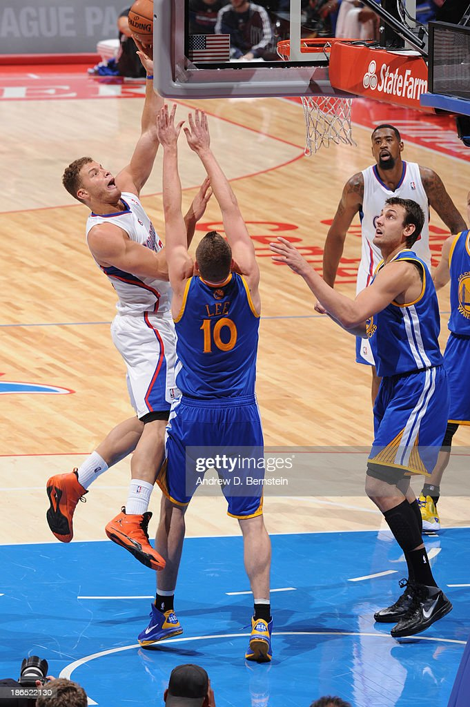 Blake Griffin #32 of the Los Angeles Clippers attempts a shot against David Lee #10 of the Golden State Warriors at STAPLES Center on October 31, 2013 at in Los Angeles, California.
