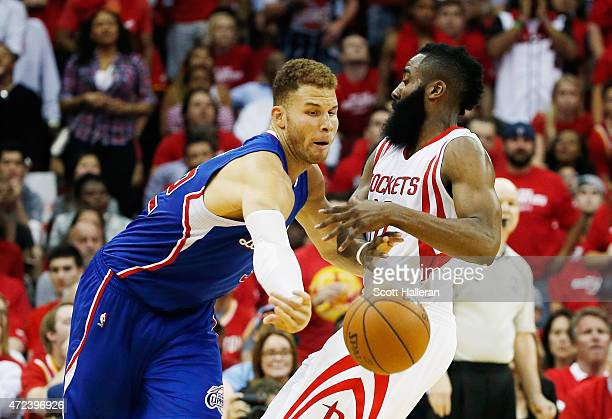 Blake Griffin of the Los Angeles Clippers battles for a loose basketball with James Harden of the Houston Rockets during Game Two in the Western...
