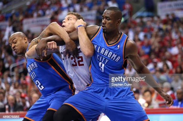 Blake Griffin of the Los Angeles Clippers battles for postion under the boards with Serge Ibaka and Caron Butler of the Oklahoma City Thunder in Game...