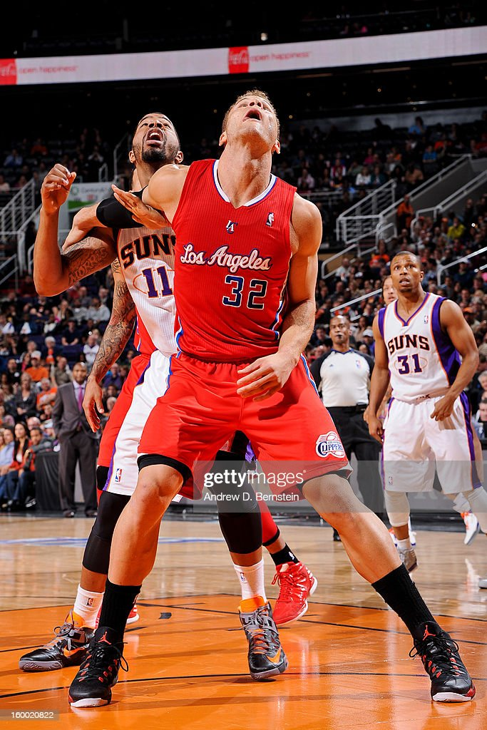 Blake Griffin #32 of the Los Angeles Clippers battles for rebound position against Markieff Morris #11 of the Phoenix Suns at US Airways Center on January 24, 2013 in Phoenix, Arizona.