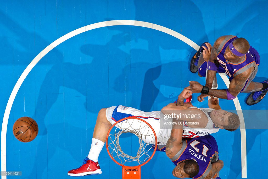 Blake Griffin #32 of the Los Angeles Clippers battles for rebound position against P.J. Tucker #17 and Jermaine O'Neal #20 of the Phoenix Suns at Staples Center on April 3, 2013 in Los Angeles, California.
