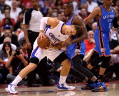 Blake Griffin of the Los Angeles Clippers battles Serge Ibaka of the Oklahoma City Thunder in Game Four of the Western Conference Semifinals during...