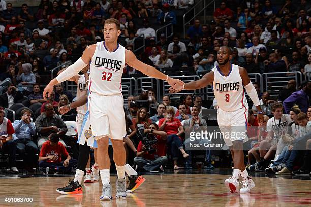 Blake Griffin of the Los Angeles Clippers celebrates a play with teammate Chris Paul of the Los Angeles Clippers during the game against the Denver...