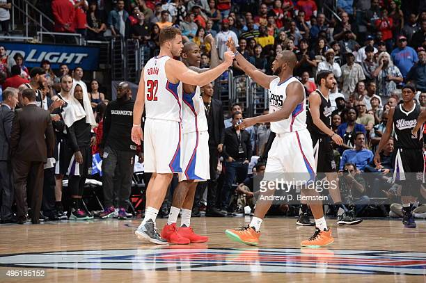 Blake Griffin of the Los Angeles Clippers celebrates with Chris Paul of the Los Angeles Clippers and Jamal Crawford of the Los Angeles Clippers...