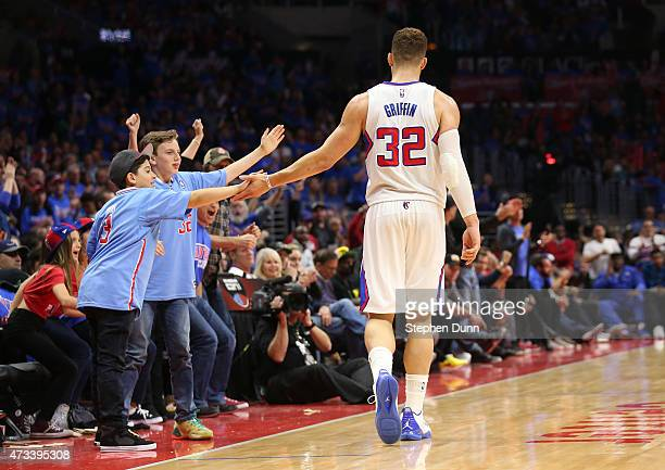 Blake Griffin of the Los Angeles Clippers celebrates with young fans in the third quarter against the Houston Rockets during Game Six of the Western...