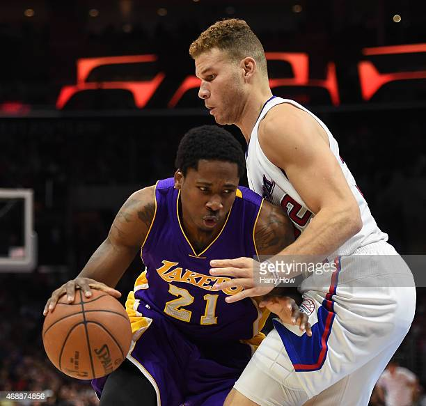 Blake Griffin of the Los Angeles Clippers defends Ed Davis of the Los Angeles Lakers at Staples Center on April 7 2015 in Los Angeles California NOTE...