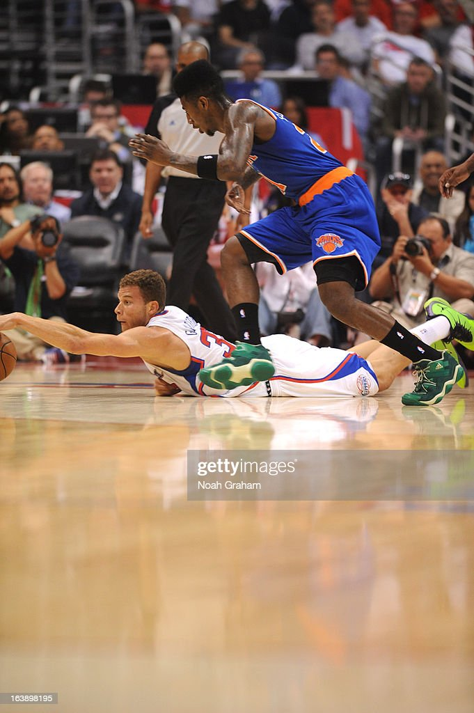 Blake Griffin #32 of the Los Angeles Clippers dives for a loose ball during the game between the Los Angeles Clippers and the New York Knicks at Staples Center on March 17, 2013 in Los Angeles, California.
