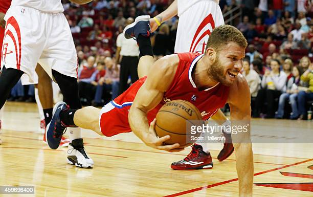 Blake Griffin of the Los Angeles Clippers dives for the basketball against the Houston Rockets at the Toyota Center on November 28 2014 in Houston...