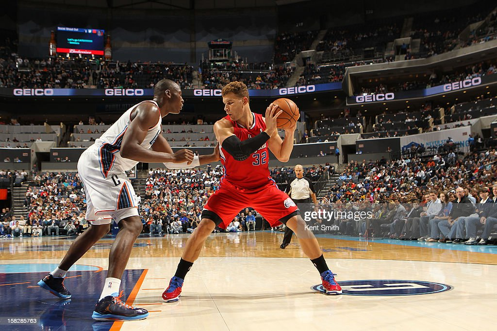 Blake Griffin #32 of the Los Angeles Clippers drives against Bismack Biyombo #0 of the Charlotte Bobcats at the Time Warner Cable Arena on December 12, 2012 in Charlotte, North Carolina.