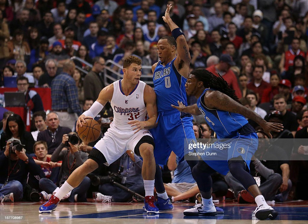 Blake Griffin #32 of the Los Angeles Clippers drives against Shawn Marion #0 and Jae Crowder #9 of the Dallas Mavericks at Staples Center on December 5, 2012 in Los Angeles, California.