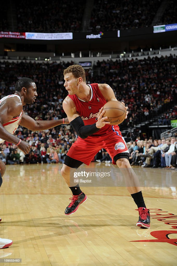 Blake Griffin #32 of the Los Angeles Clippers drives the ball against Patrick Patterson #54 of the Houston Rockets on January 15, 2013 at the Toyota Center in Houston, Texas.