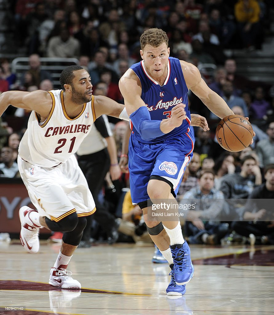 Blake Griffin #32 of the Los Angeles Clippers drives the fast break after stealing the ball trailed by Wayne Ellington #21 of the Cleveland Cavaliers at The Quicken Loans Arena on March 1, 2013 in Cleveland, Ohio.