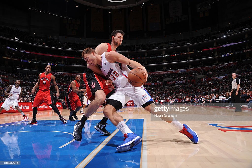 Blake Griffin #32 of the Los Angeles Clippers drives to the basket against Andrea Bargnani #7 of the Toronto Raptors at Staples Center on December 9, 2012 in Los Angeles, California.