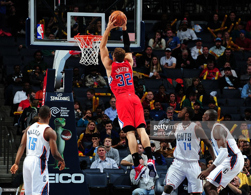 <a gi-track='captionPersonalityLinkClicked' href=/galleries/search?phrase=Blake+Griffin+-+Basketspelare&family=editorial&specificpeople=4216010 ng-click='$event.stopPropagation()'>Blake Griffin</a> #32 of the Los Angeles Clippers dunks against the Charlotte Bobcats at Time Warner Cable Arena on December 12, 2012 in Charlotte, North Carolina.