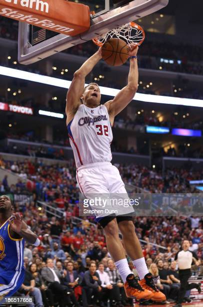 Blake Griffin of the Los Angeles Clippers dunks against the Golden State Warriors at Staples Center on October 31 2013 in Los Angeles California The...