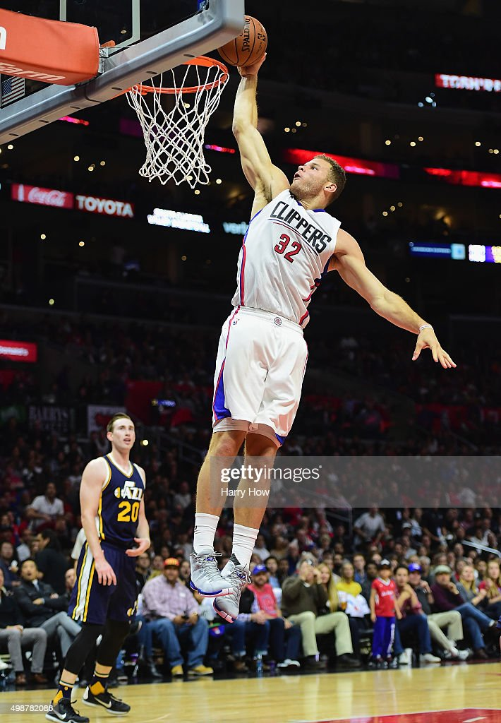 Blake Griffin of the Los Angeles Clippers dunks as Gordon Hayward of the Utah Jazz looks on during the first half at Staples Center on November 25...
