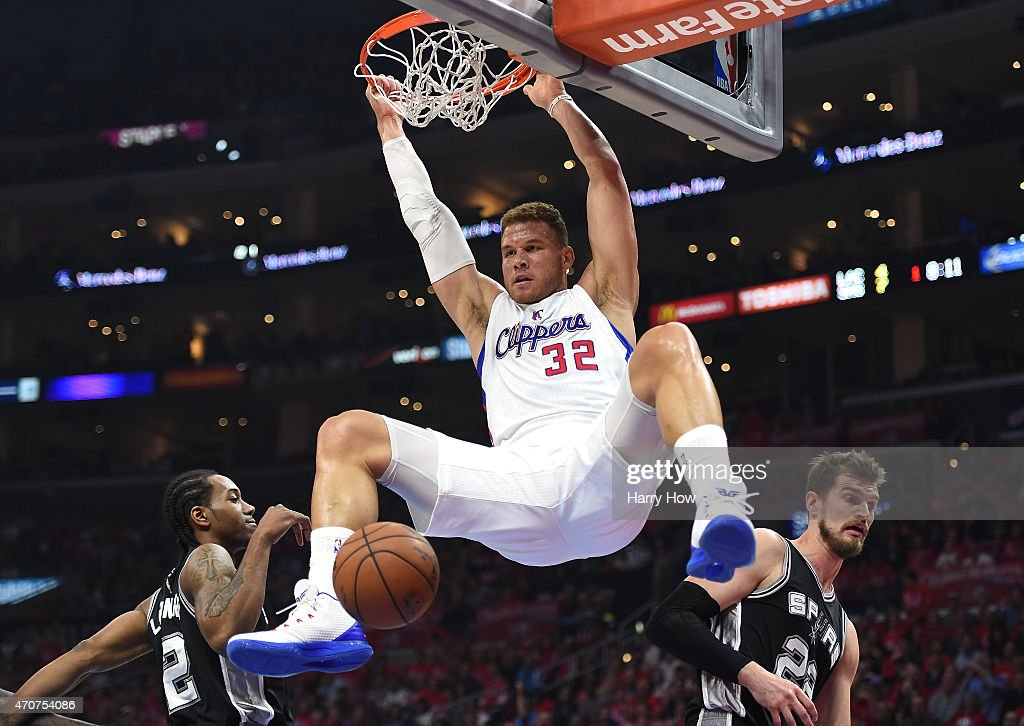 <a gi-track='captionPersonalityLinkClicked' href=/galleries/search?phrase=Blake+Griffin&family=editorial&specificpeople=4216010 ng-click='$event.stopPropagation()'>Blake Griffin</a> #32 of the Los Angeles Clippers dunks between <a gi-track='captionPersonalityLinkClicked' href=/galleries/search?phrase=Kawhi+Leonard&family=editorial&specificpeople=6691012 ng-click='$event.stopPropagation()'>Kawhi Leonard</a> #2 and <a gi-track='captionPersonalityLinkClicked' href=/galleries/search?phrase=Tiago+Splitter&family=editorial&specificpeople=208218 ng-click='$event.stopPropagation()'>Tiago Splitter</a> #22 of the San Antonio Spurs during the first half of Game Two of the Western Conference quarterfinals of the 2015 NBA Playoffs at Staples Center on April 22, 2015 in Los Angeles, California.