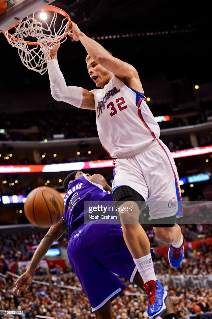 Blake Griffin #32 of the Los Angeles Clippers dunks on an alley-oop pass against John Salmons #5 of the Sacramento Kings at Staples Center on December 21, 2012 in Los Angeles, California.