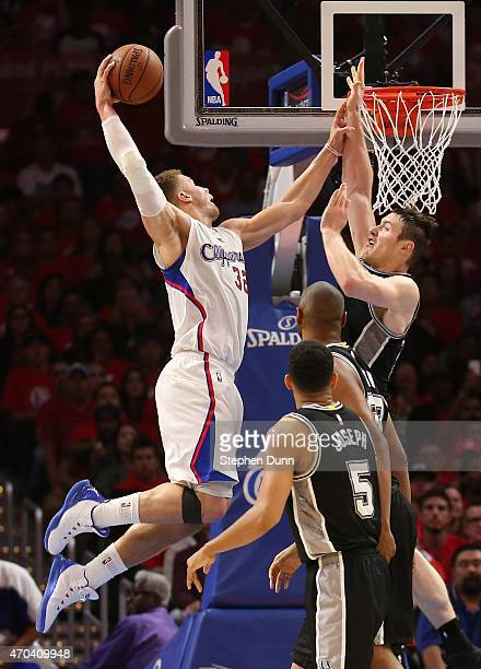 Blake Griffin of the Los Angeles Clippers dunks over Aron Baynes of the San Antonio Spurs during Game One of the Western Conference quarterfinals of...