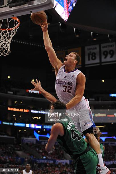 Blake Griffin of the Los Angeles Clippers dunks over Kris Humphries of the Boston Celtics at Staples Center on January 8 2014 in Los Angeles...