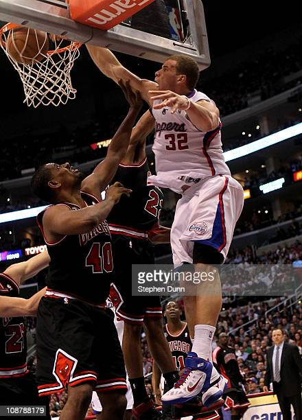 Blake Griffin of the Los Angeles Clippers dunks over Kurt Thomas of the Chicago Bulls at Staples Center on February 2 2011 in Los Angeles California...