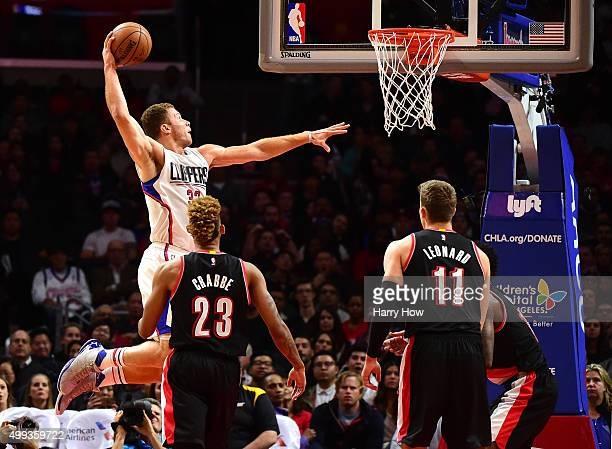 Blake Griffin of the Los Angeles Clippers dunks past Allen Crabbe and Meyers Leonard of the Portland Trail Blazers during the first half at Staples...