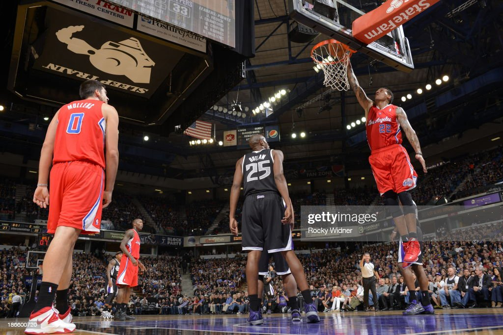 Blake Griffin #32 of the Los Angeles Clippers dunks the ball against Travis Outlaw #25 of the Sacramento Kings at Sleep Train Arena on November 1, 2013 in Sacramento, California.