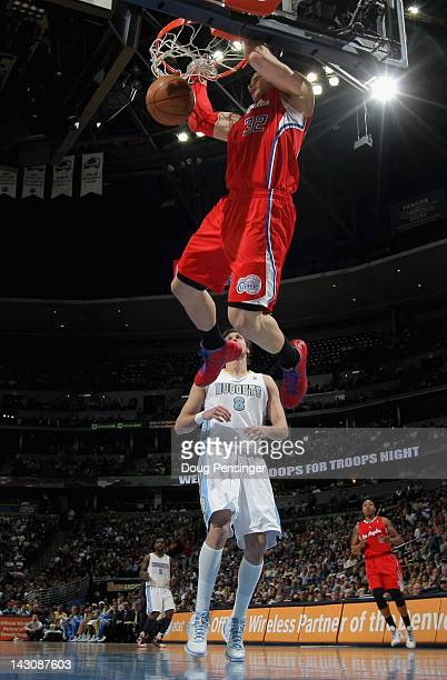 Blake Griffin of the Los Angeles Clippers dunks the ball over Danilo Gallinari of the Denver Nuggets at Pepsi Center on April 18 2012 in Denver...