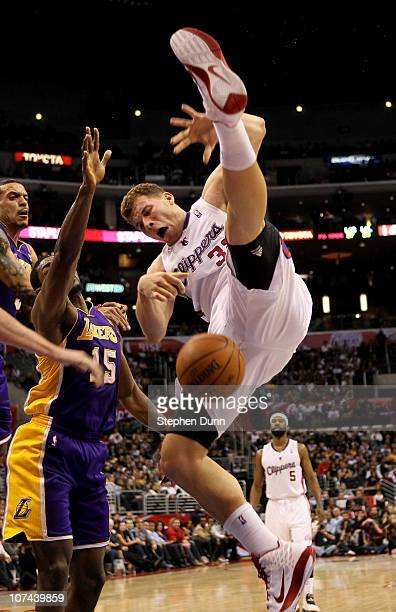 Blake Griffin of the Los Angeles Clippers falls to the florr after being fouled by Matt Barnes 9 of the Los Angeles Lakers as Ron Artest also defends...