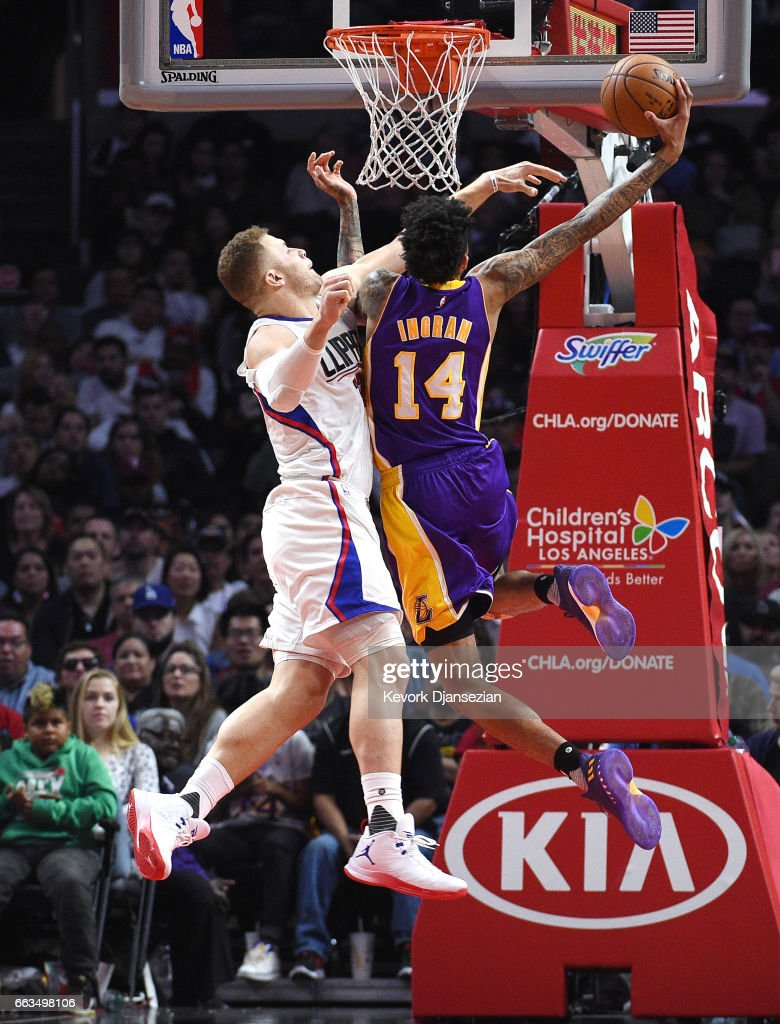 Blake Griffin #32 of the Los Angeles Clippers fouls Brandon Ingram #14 of the Los Angeles Lakers as he goes up for a layup during the second half at Staples Center April 1, 2017 in Los Angeles, California.