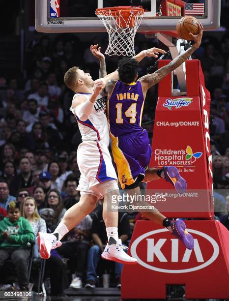 Blake Griffin of the Los Angeles Clippers fouls Brandon Ingram of the Los Angeles Lakers as he goes up for a layup during the second half at Staples...