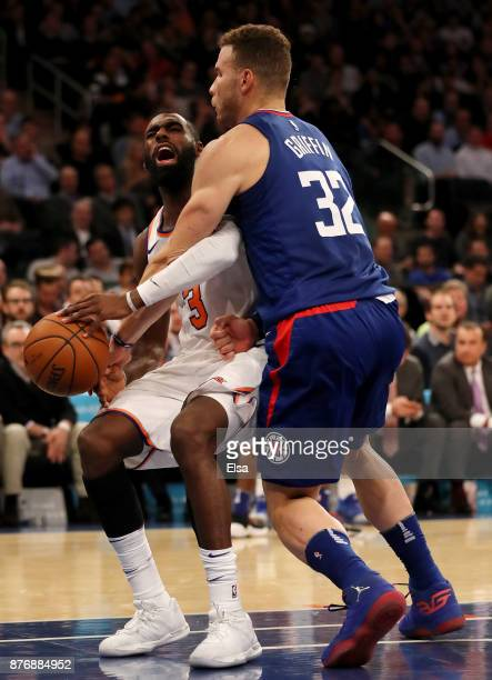 Blake Griffin of the Los Angeles Clippers fouls Tim Hardaway Jr #3 of the New York Knicks in the fourth quarter at Madison Square Garden on November...