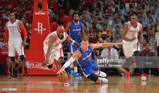 Blake Griffin of the Los Angeles Clippers goes after the loose ball against the Houston Rockets at the Toyota Center During Game One of the Western...