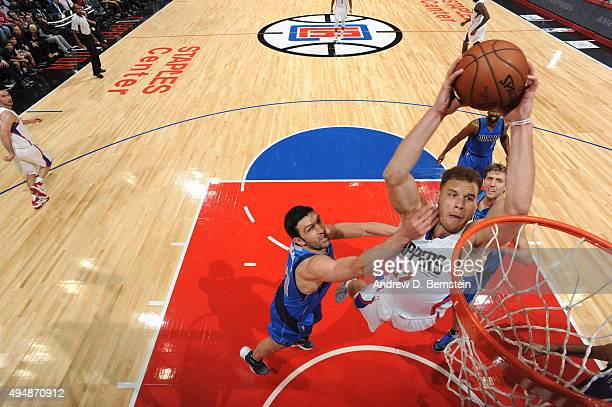 Blake Griffin of the Los Angeles Clippers goes for the layup against Zaza Pachulia of the Dallas Mavericks during the game on October 29 2015 at...