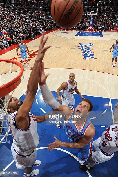 Blake Griffin of the Los Angeles Clippers goes to the basket against Tim Duncan of the San Antonio Spurs at Staples Center on February 18 2012 in Los...