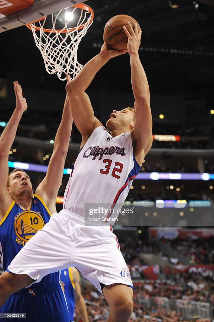Blake Griffin #32 of the Los Angeles Clippers goes to the basket against David Lee #10 of the Golden State Warriors during the game between the Los Angeles Clippers and the Golden State Warriors at Staples Center on November 3, 2012 in Los Angeles, California.
