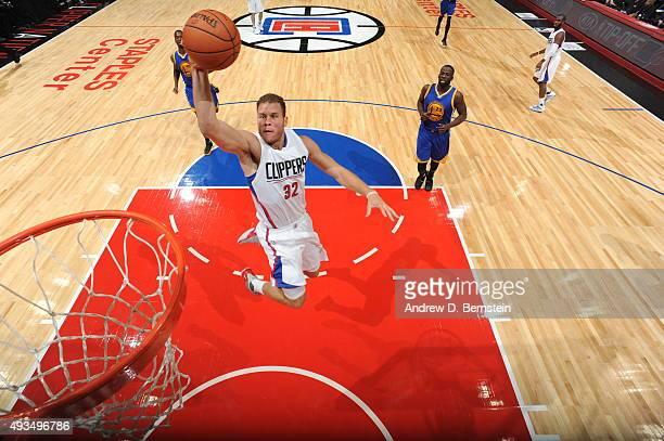 Blake Griffin of the Los Angeles Clippers goes to the basket against the Golden State Warriors on October 20 2015 at STAPLES Center in Los Angeles...