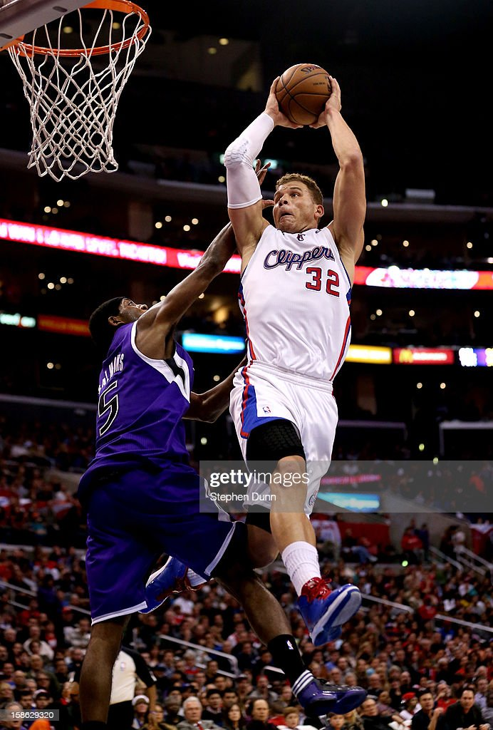 Blake Griffin #32 of the Los Angeles Clippers goes up for a dunk on a lob play over John Salmons #5 of the Sacramento Kings at Staples Center on December 21, 2012 in Los Angeles, California.